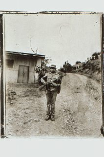 A lone soldier stands in a road in a rural Nicaraguan town