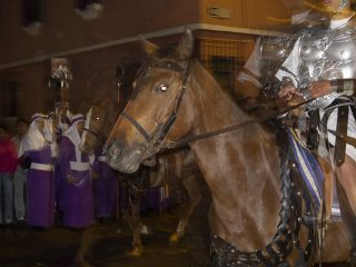 Double exposure of a man in armor riding a horse