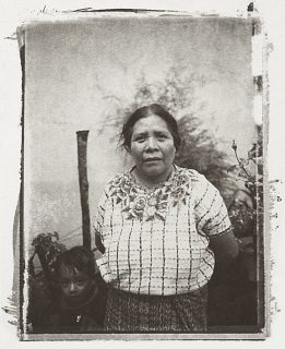 A portrait of Mayan woman with child, brown and white, from Polaroid negative