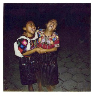 Color Polaroid Photograph of two Mayan girls laughing
