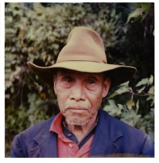 Old Guatemalan Man Wearing Hat, color Polaroid Photograph, portrait from shoulders to head