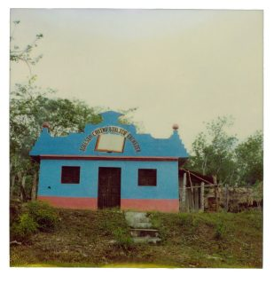 Color Polaroid, small blue church on hill in Guatemalan jungle, color Polaroid photograph